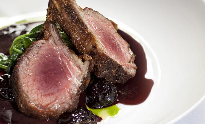 Jason Tilmann's Coriander Crusted Lamb Rack with Foie Gras Stuffed Prune & Port Wine Reduction Recipe | D'Artagnan