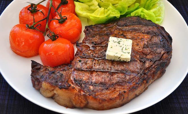 Grilled Ribeye Steak with Basil Butter & Blistered Tomatoes Recipe | D'Artagnan