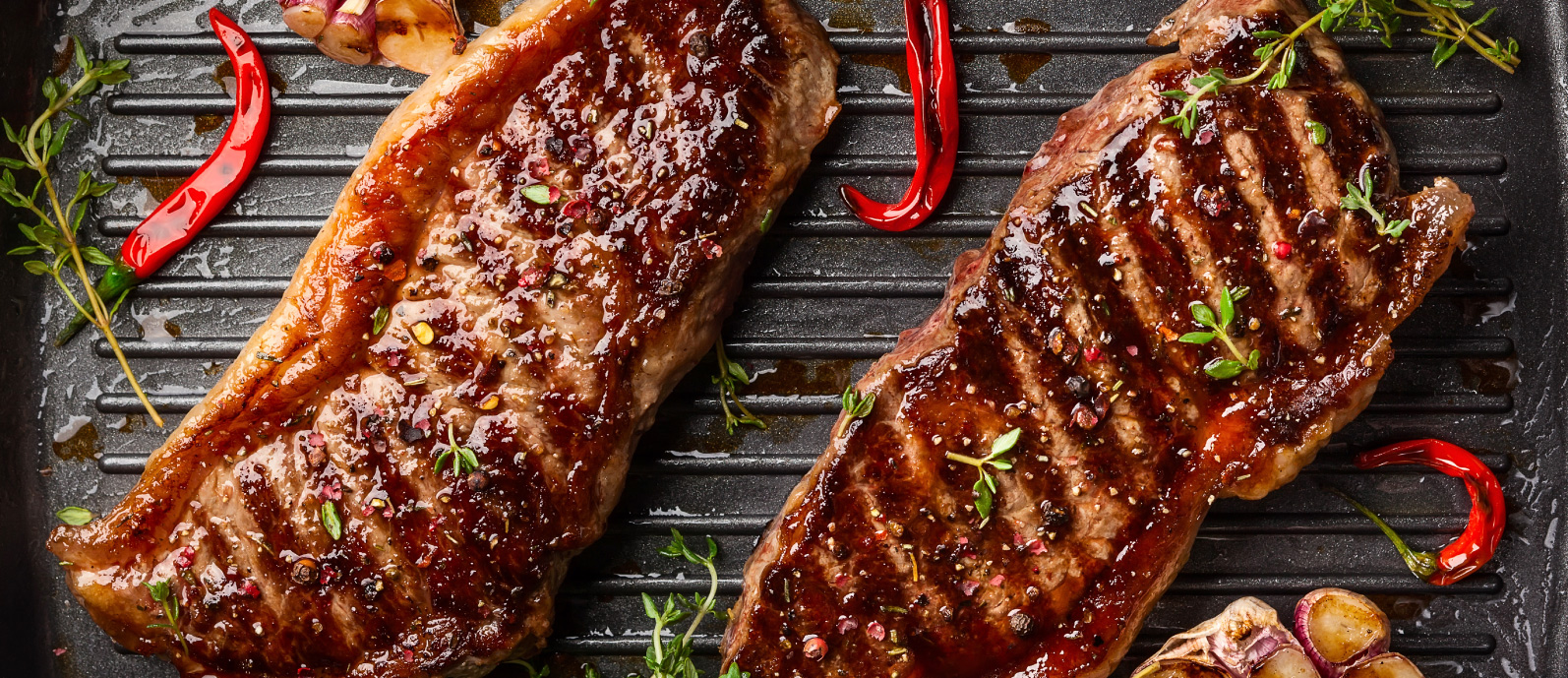 4 FREEGRASS-FED STRIP STEAKS (a $79.99 value) with orders of $125+